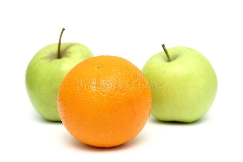 Äpfel und Orange stockfotografie