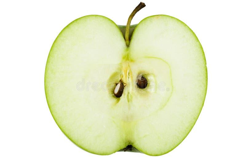 äpple - grön hälft arkivfoton