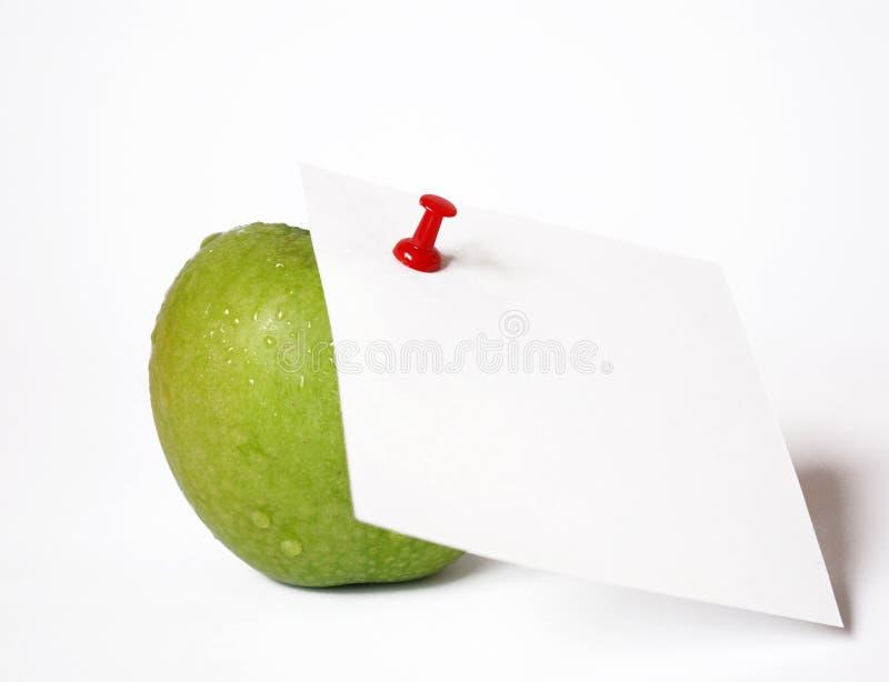 äpple - grönt anmärkningspapper royaltyfri bild