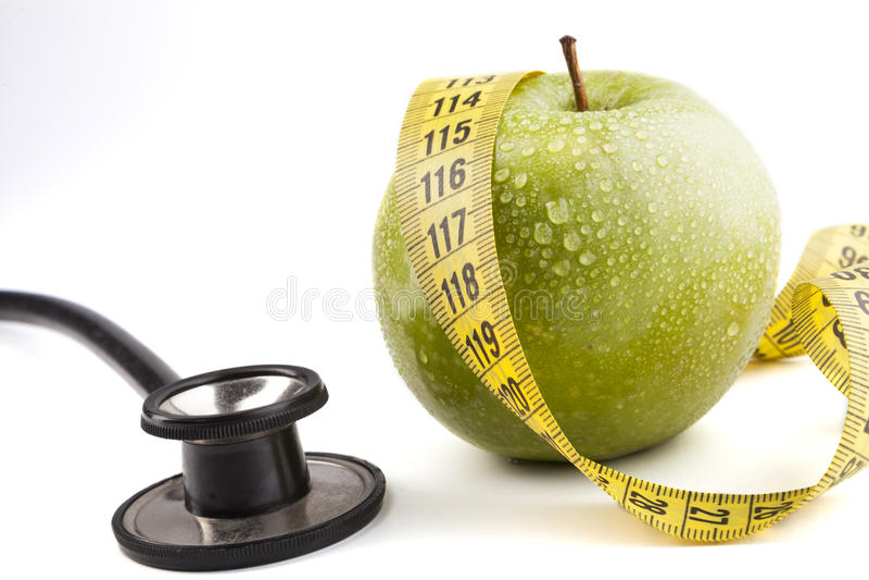 äpple - grönt stetoskop arkivbild