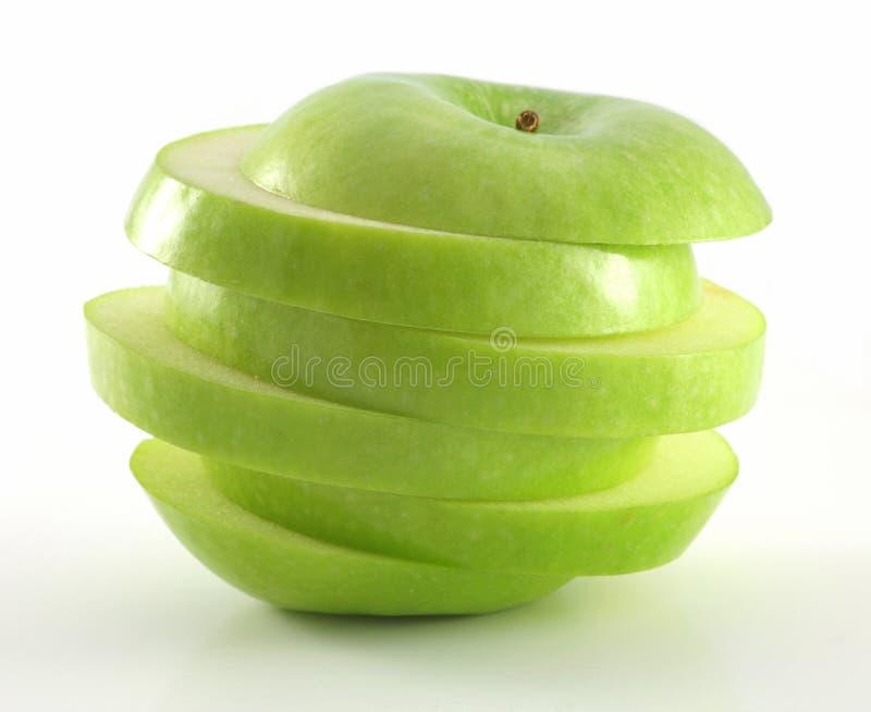 äpple - green skivade royaltyfri bild