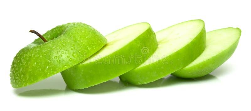 äpple klippta gröna delar royaltyfri bild