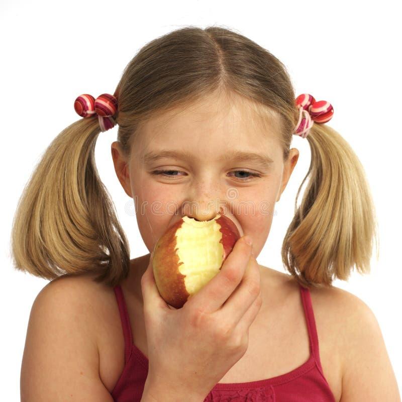 äpple som äter flickan fotografering för bildbyråer
