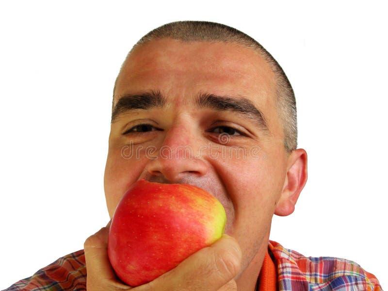 äpple som bitting royaltyfri foto
