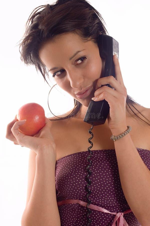 äpplefelanmälanstelefon royaltyfri bild