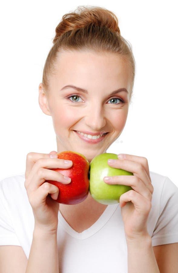 äpplen bantar sund kvinna två arkivbild