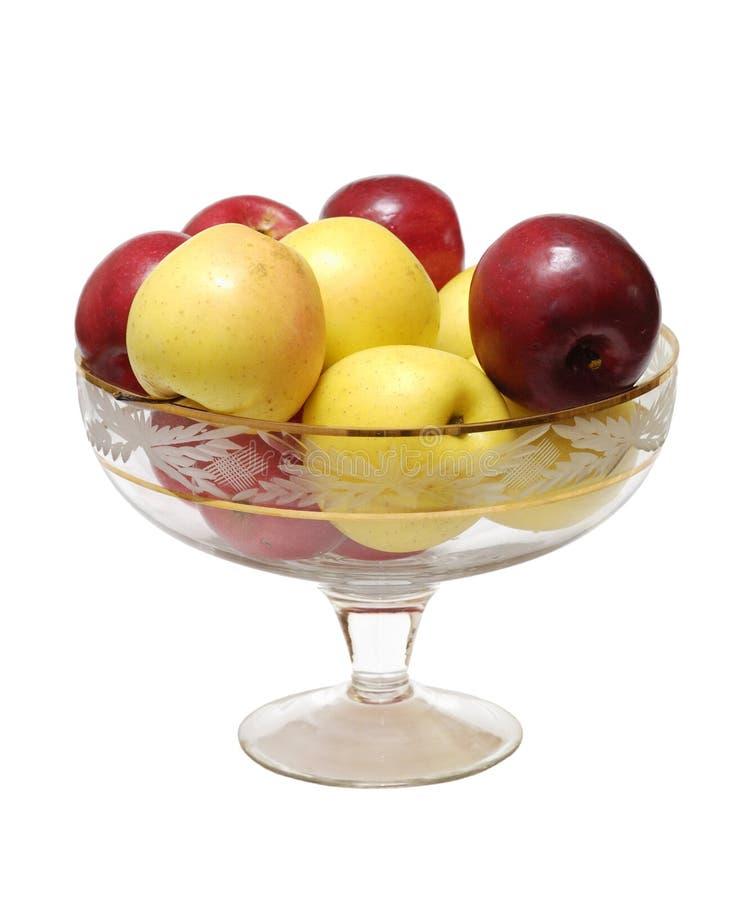 äpplen isolerade vasen royaltyfria bilder