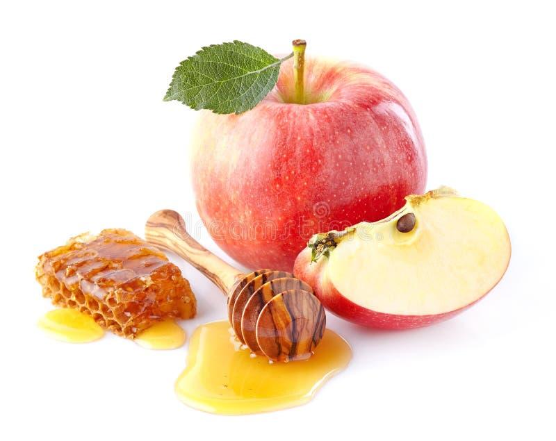 Äpplen med honung arkivfoto