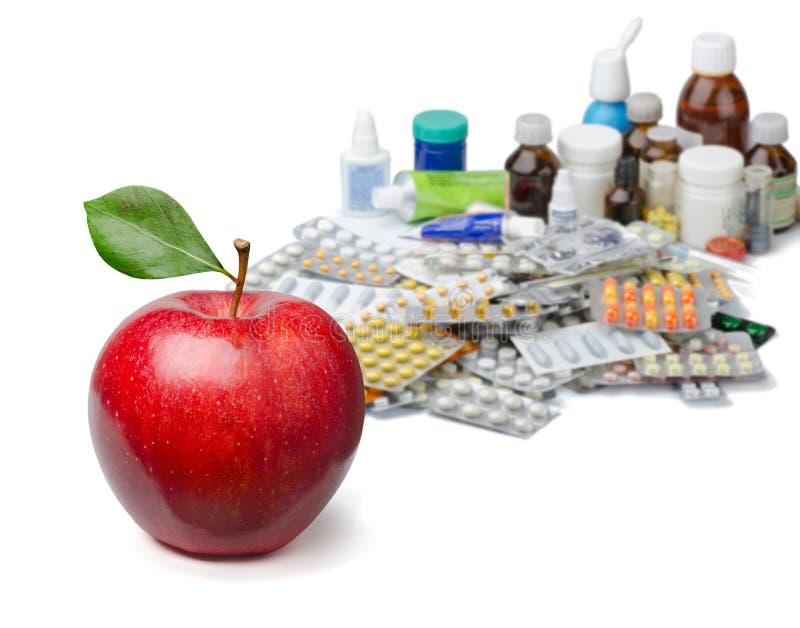 Äpplen och pills royaltyfri foto
