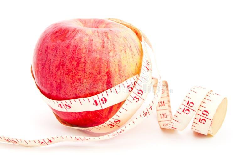 äpplen som äter sund isolerad white arkivfoto