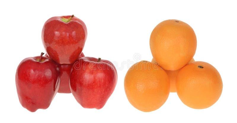 äpplen som jämför apelsiner till royaltyfria bilder
