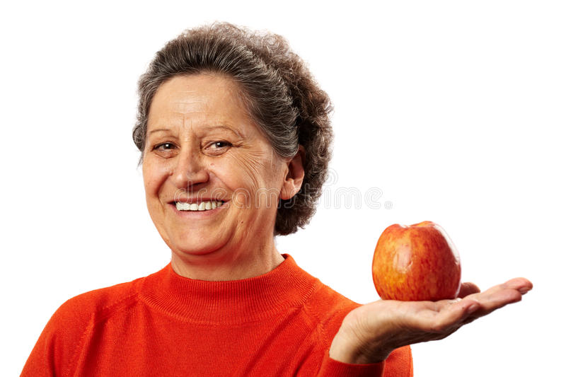 äpplepensionärkvinna royaltyfri fotografi