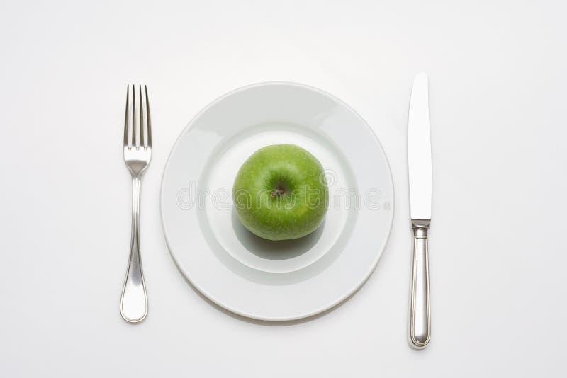 äpplet bantar matplattan arkivfoton