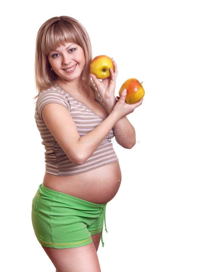 äpplet hands ståendegravid kvinna royaltyfria foton