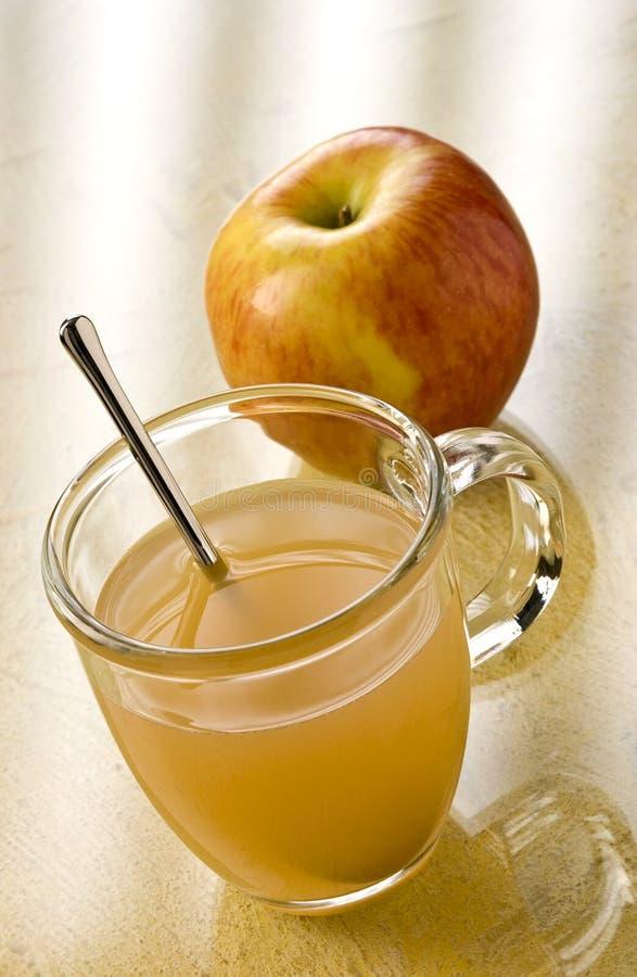 äpplet slings toddyen arkivfoton
