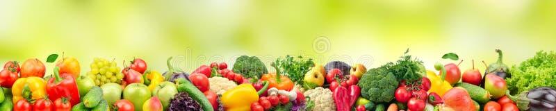 Är sunda och användbara grönsaker för panorama- brett foto och frukter stock illustrationer