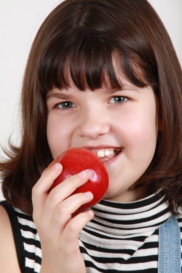 äta för äpple arkivfoto