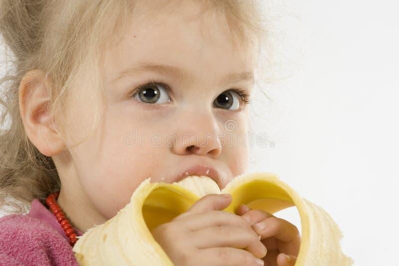 äta för banan arkivfoto