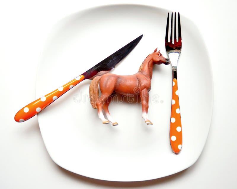 Problemet med att äta hästmeat royaltyfri bild