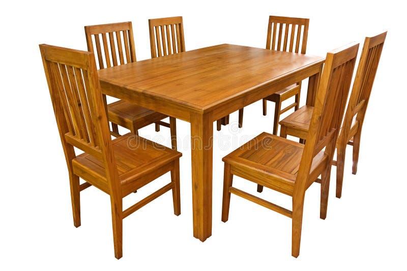 Äta middag den isolerade tabellen och stolar arkivfoton