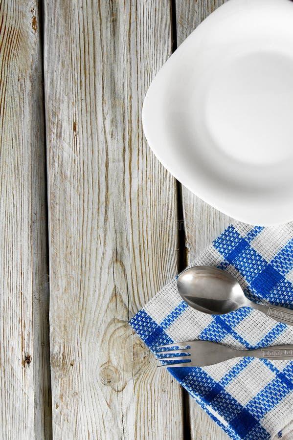 Äta middag lättheter och plattan. arkivfoton
