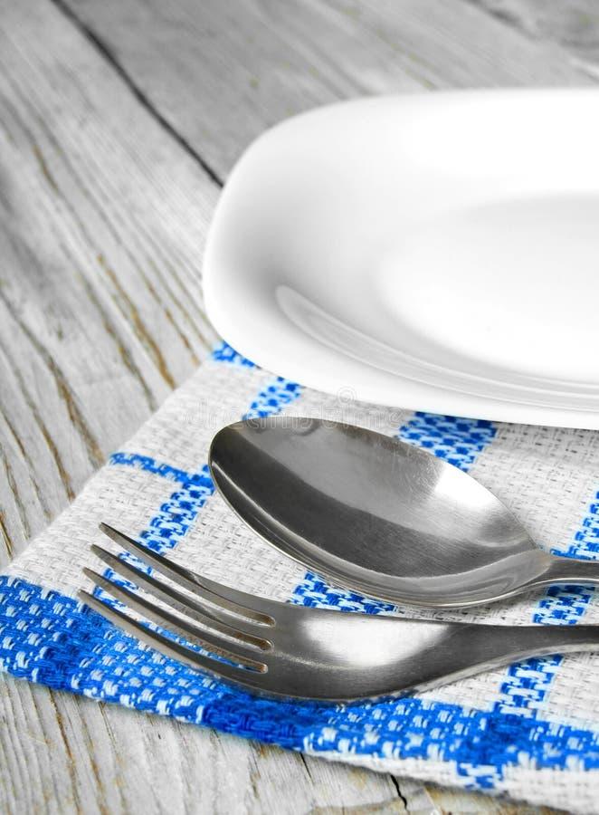 Äta middag lättheter och plattan. royaltyfria foton
