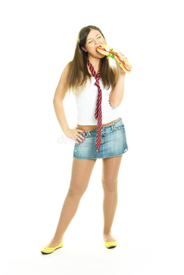 äta nätt sandwitch för flicka arkivfoto
