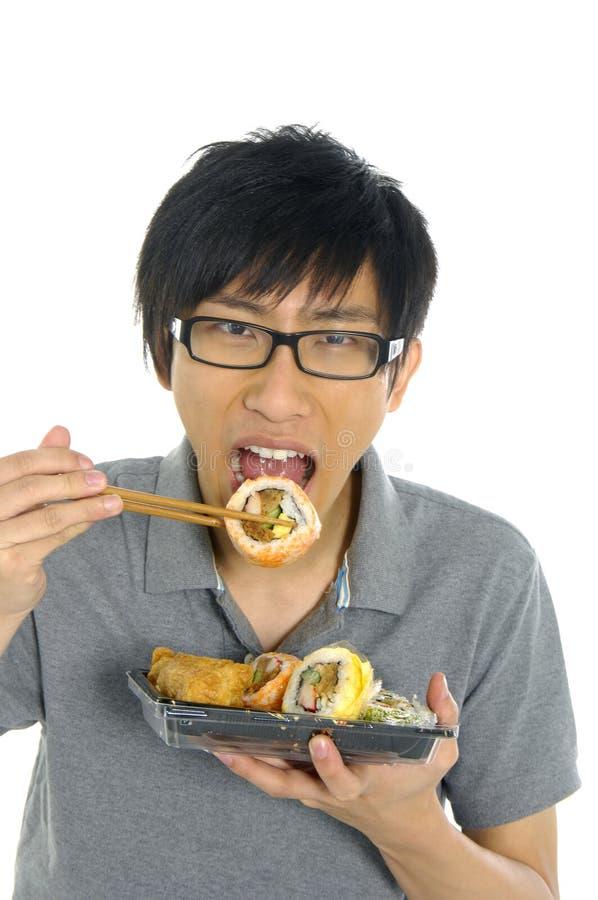 äta sushi royaltyfri bild