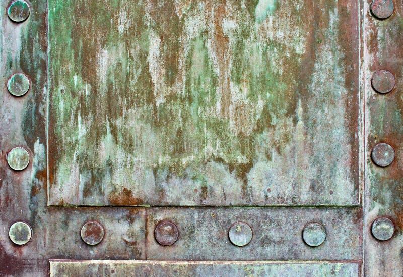 古铜色门细节  免版税库存照片