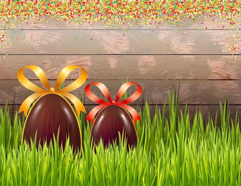 复活节构成用在土气木背景和糖丸状药的朱古力蛋 复制空间 皇族释放例证