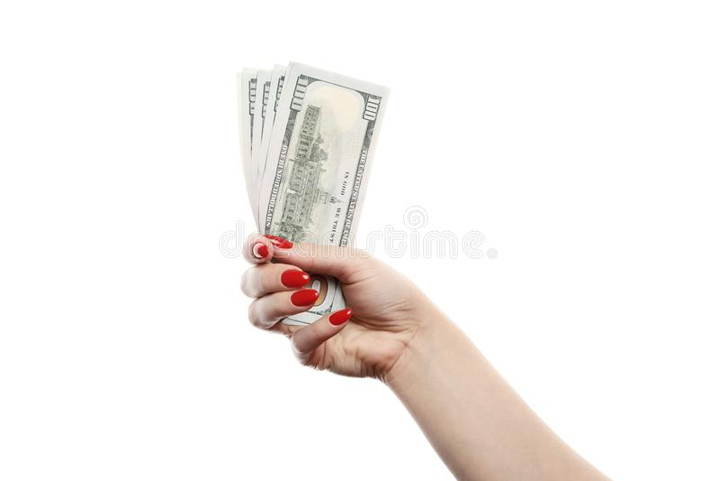 女孩在白色背景拿着很多一百元钞票被隔绝 免版税库存图片