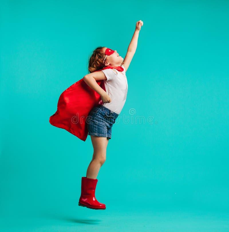 女孩儿童游戏超级英雄 图库摄影