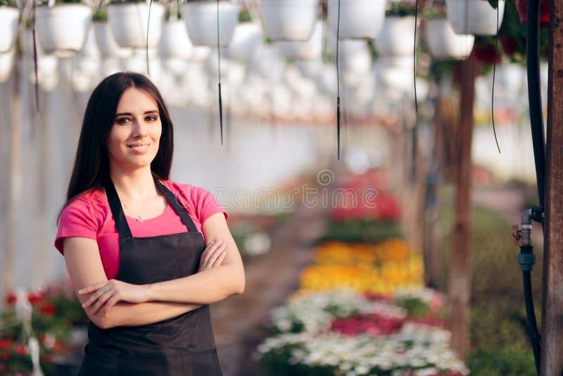 女性企业家花温室工作者 免版税图库摄影