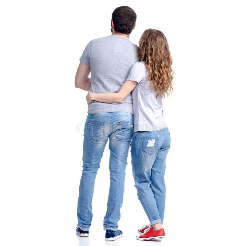 妇女和人站立的牛仔裤的看 免版税图库摄影