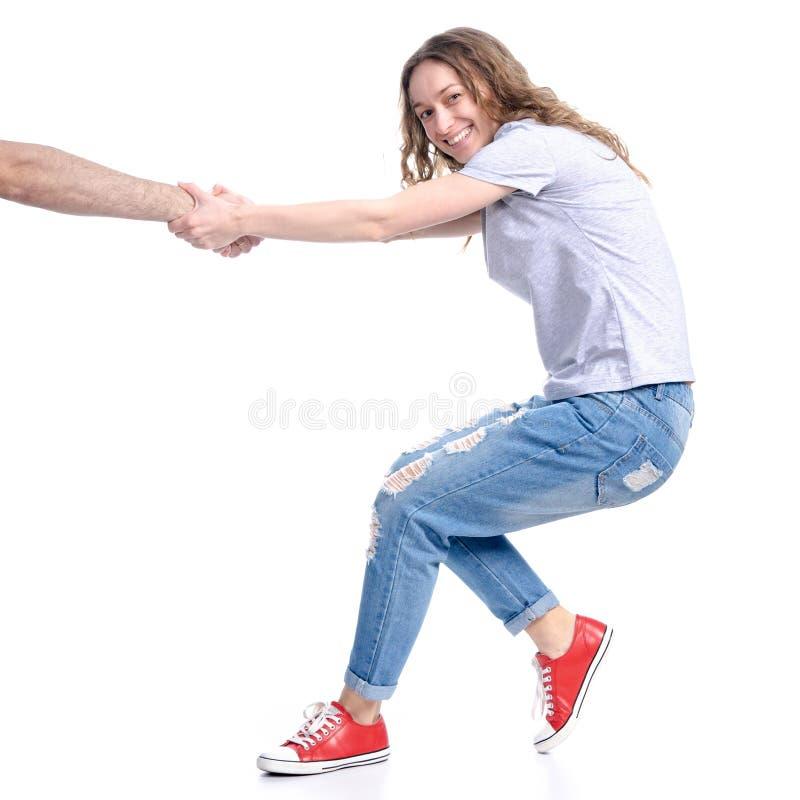 妇女拉扯一个人的手 免版税库存图片