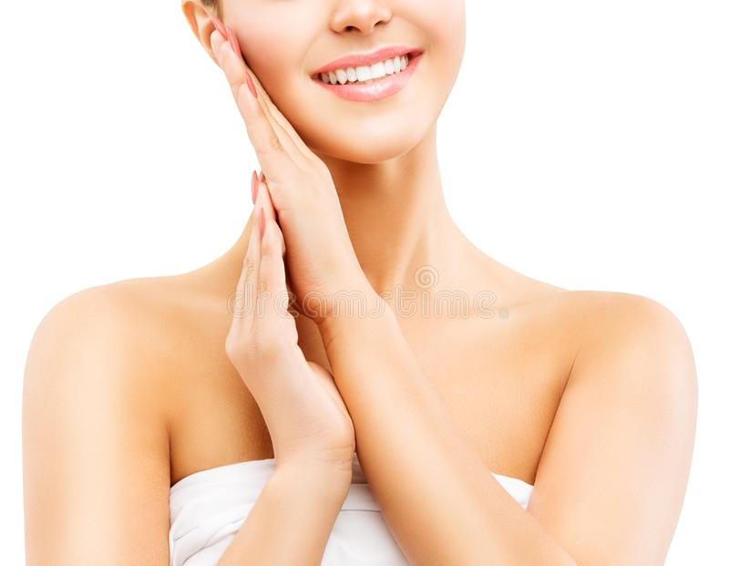 妇女秀丽微笑,用手接触面孔皮肤的美丽的微笑的女孩在白色 免版税库存图片