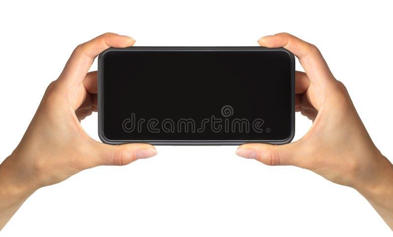 妇女的手陈列黑色照相的智能手机、概念或selfie 免版税库存图片