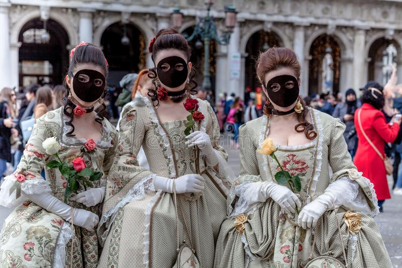 威尼斯,意大利,威尼斯狂欢节,在圣马可广场的美好的面具 图库摄影