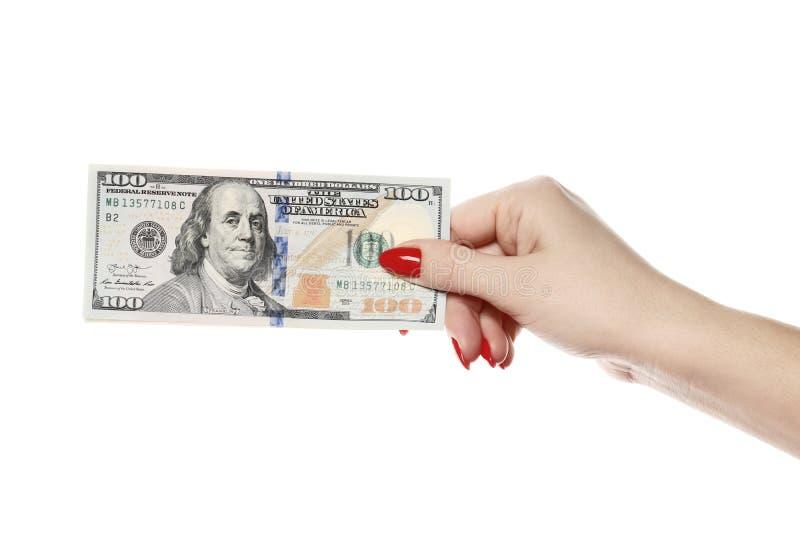 完善的妇女递举行在白色背景隔绝的一百美元 库存照片