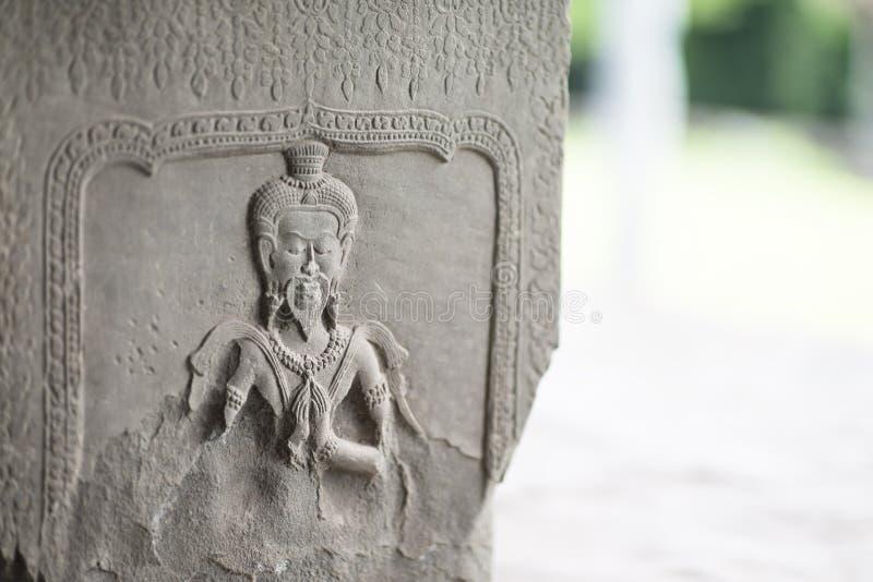 安心雕刻接近的细节在吴哥窟寺庙,暹粒市,柬埔寨的 免版税库存图片