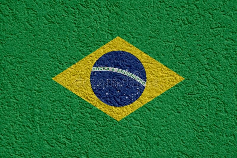 巴西政治或企业概念:有膏药的,纹理巴西旗子墙壁 免版税库存图片