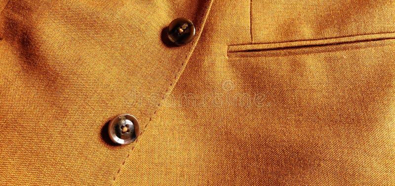 布朗橙色羊毛外套关闭 免版税图库摄影