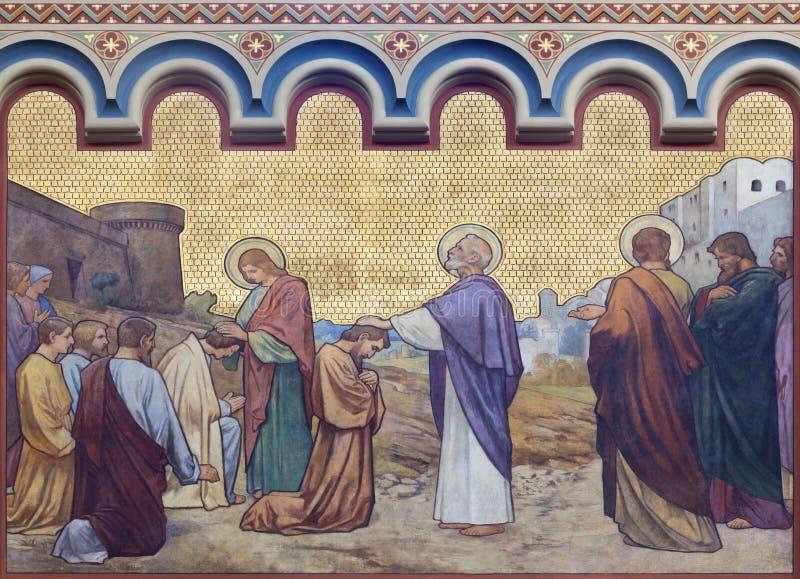布拉格,捷克- 2018年:壁画传道者彼得和约翰在教会kostel的Svatého Cyrila Metodeje耶路撒冷愈合 库存照片
