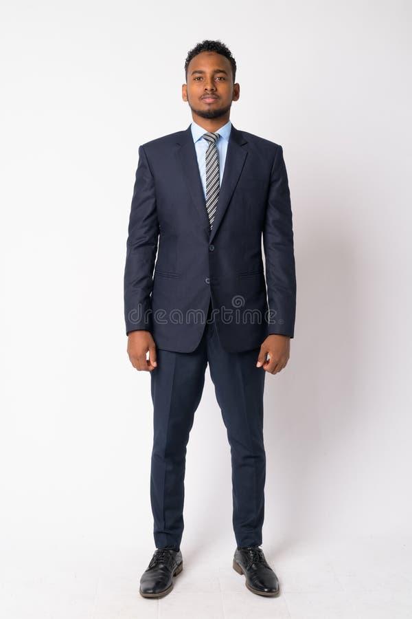 年轻英俊的非洲商人充分的身体射击在衣服的 免版税图库摄影