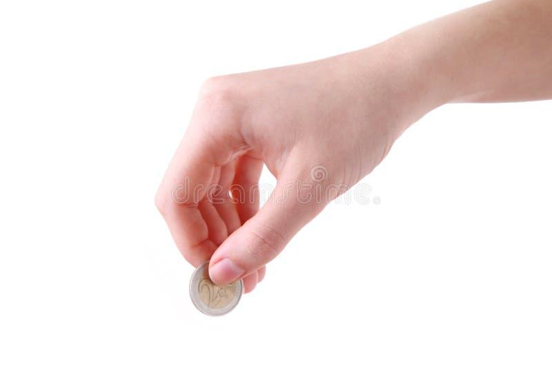 Żeński ręka chwyt moneta odizolowywał biel przy studiiem obraz royalty free