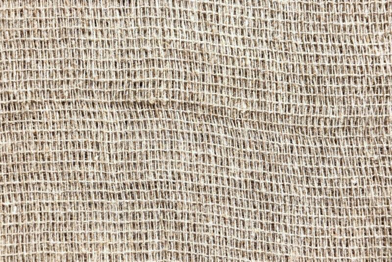 很少被编织的灰色粗糙的织品 麻袋布 免版税库存照片