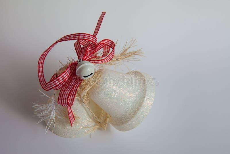 圣诞节与一条红色丝带的玩具两响铃 库存图片