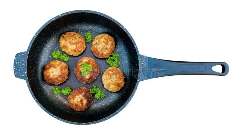 在平底锅的肉炸肉排 库存照片