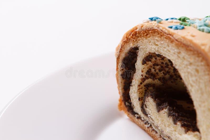 在板材的鸦片蛋糕 库存图片