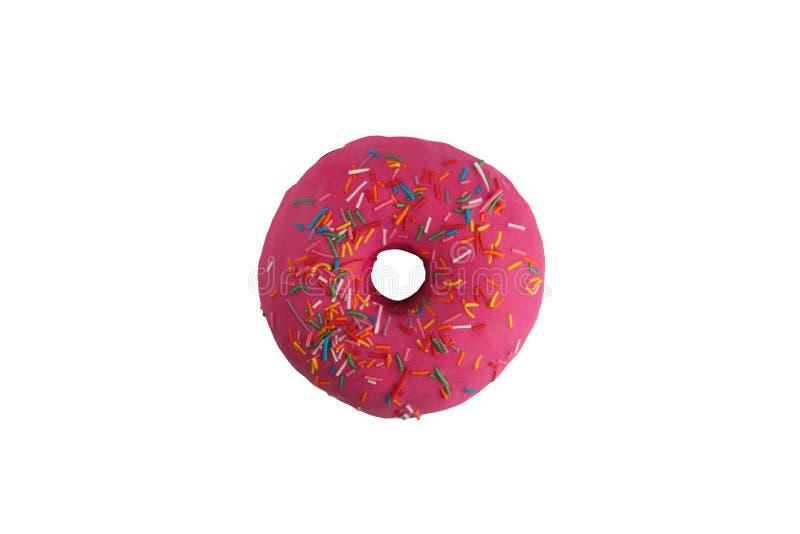 在桃红色釉的开胃多福饼与多彩多姿在白色背景洒 查出 库存图片